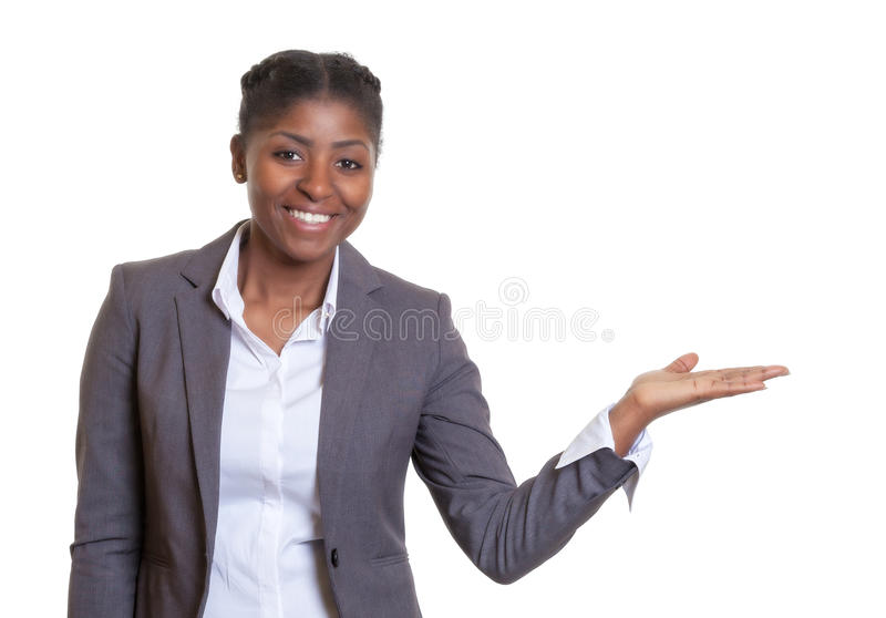Presentation of a laughing African business woman. On an isolated white background for cut out royalty free stock photography