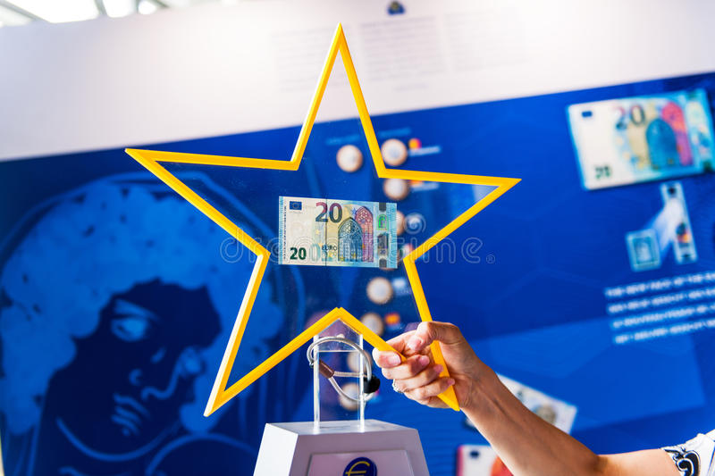 Presentation of the new 20 Euro banknotes by the European Central Bank official. STRASBOURG, FRANCE - MAY 2, 2015: Presentation of the new 20 Euro banknotes by royalty free stock photography