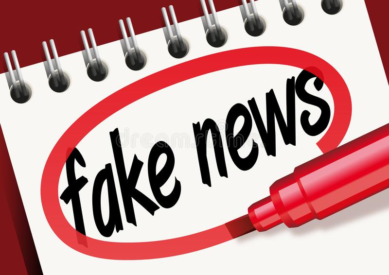 The word fake news noted on a notepad and surrounded by red stock illustration