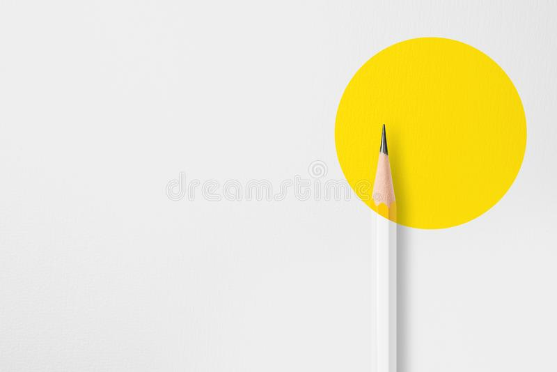 Yellow pencil with yellow circle royalty free stock images