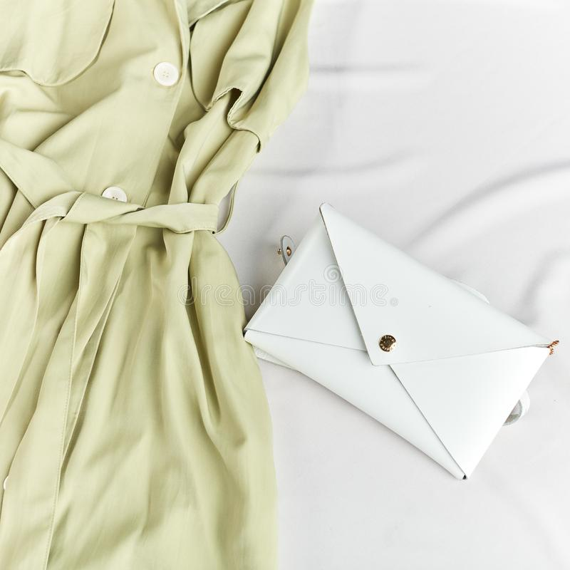 Presentation of white clutch which suits with aany dress royalty free stock image
