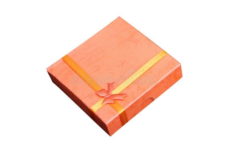 Presente arancione isolato della casella fotografia stock libera da diritti