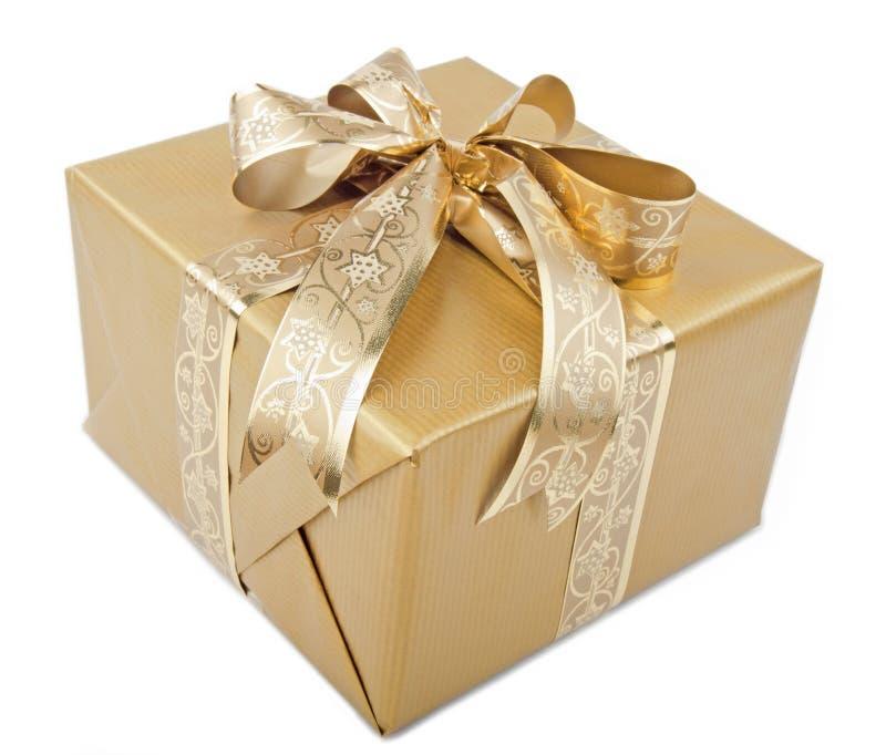 Presente con la cinta del oro fotografía de archivo libre de regalías