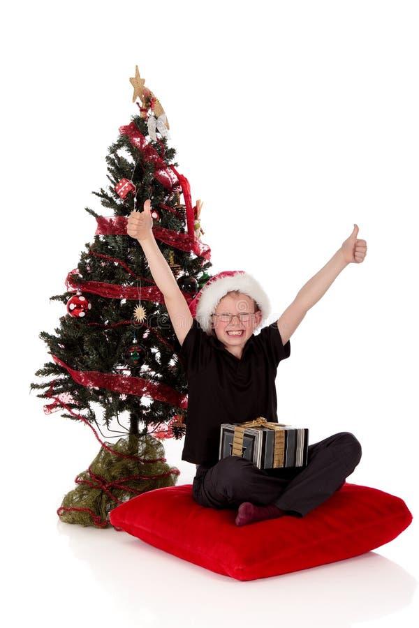 Presente de Natal do menino fotos de stock