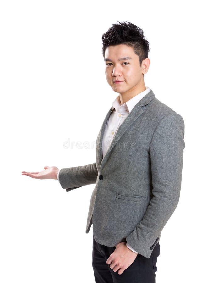 Presente do homem de negócios de Ásia imagem de stock