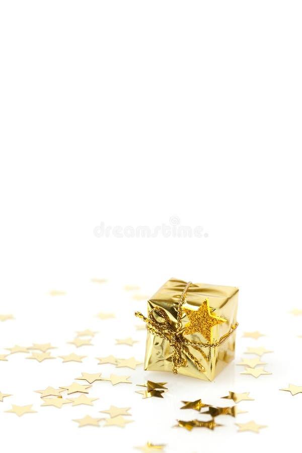 Presente dorato fotografie stock