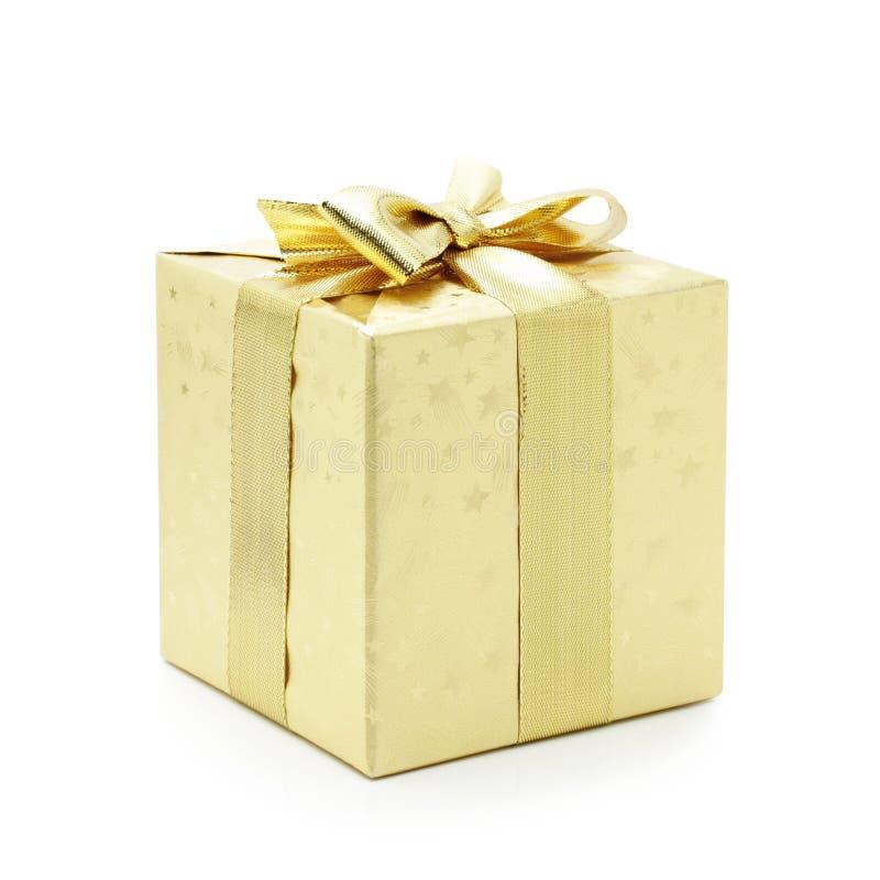 Presente dorato immagine stock