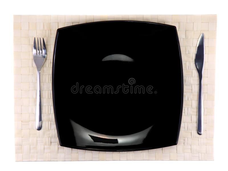 Presente el porción-cuchillo, placa, bifurcación en el contexto del color. fotografía de archivo libre de regalías
