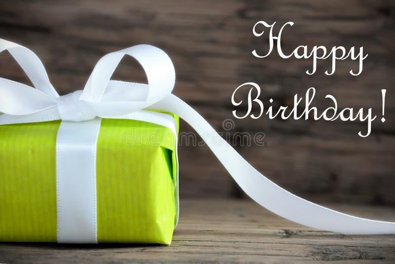 Presente verde com feliz aniversario fotos de stock