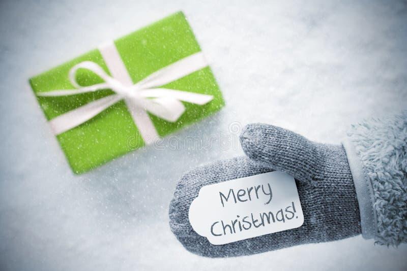 Presente verde, luva, Feliz Natal do texto, flocos de neve foto de stock