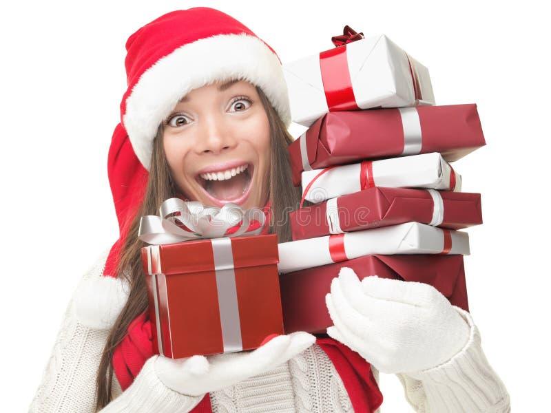 Presentes da terra arrendada da mulher da compra do Natal foto de stock royalty free