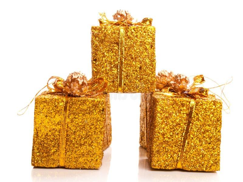 Presentes de oro fotos de archivo libres de regalías