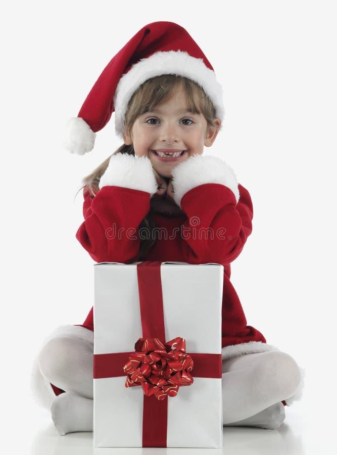 Download Presentes De Una Niña Y De Navidad Foto de archivo - Imagen de celebración, poco: 7150406