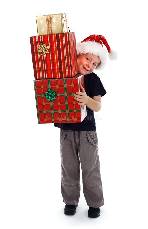 Presentes sonrientes de la explotación agrícola del muchacho imagen de archivo libre de regalías