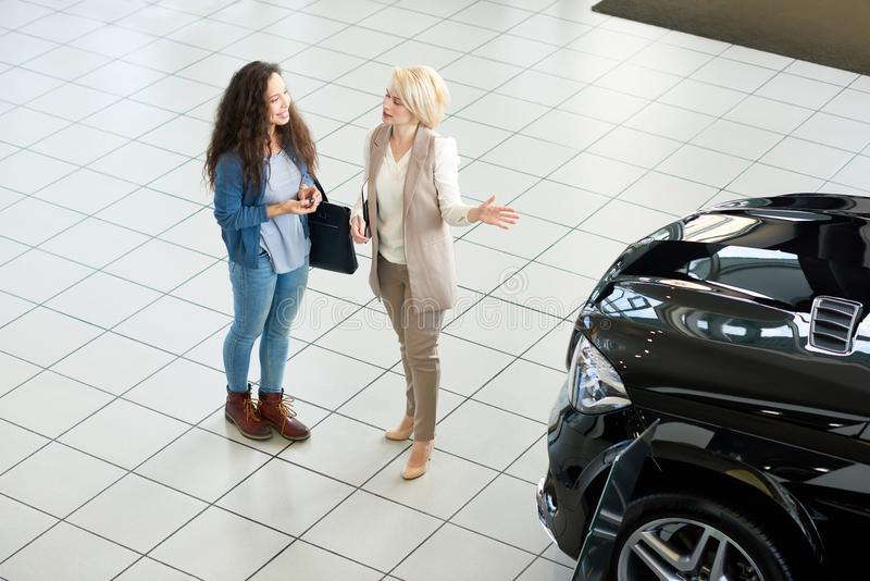 Presenting New Car to Customer stock images
