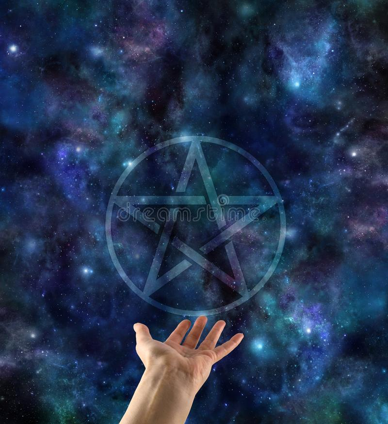 Presenting the Pentacle against starry night sky stock photo