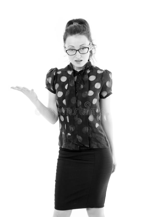 Presenting something special. Successful business lady stretching her hand away. Pretty woman wearing glasses with smart royalty free stock photography