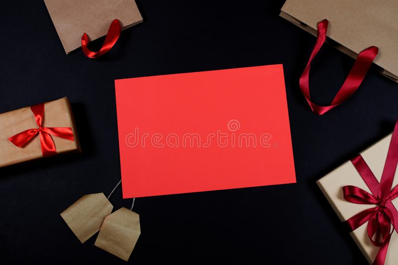 Presents and bags on black background royalty free stock photos