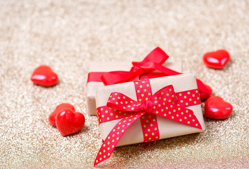 Presents. Box for present and red hearts on a table stock photography