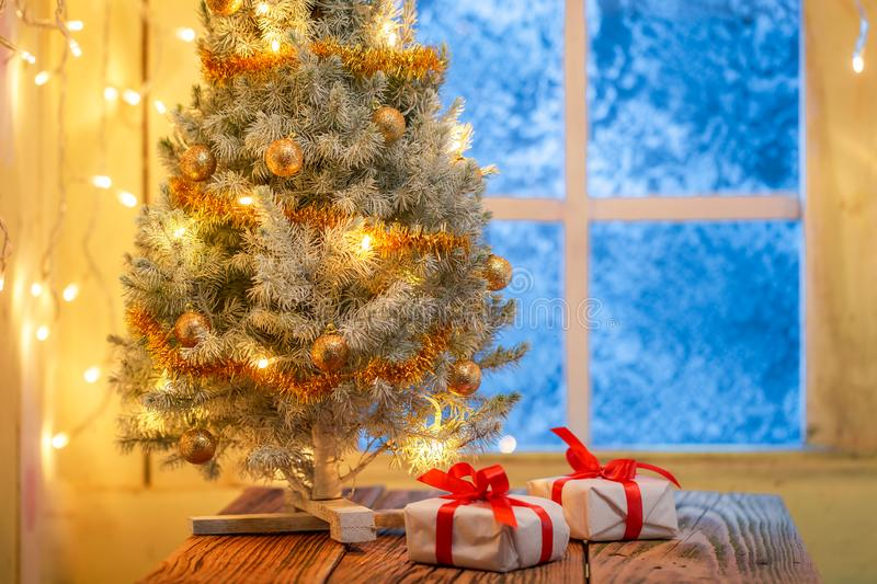Presents and Christmas tree in old rustic house royalty free stock image