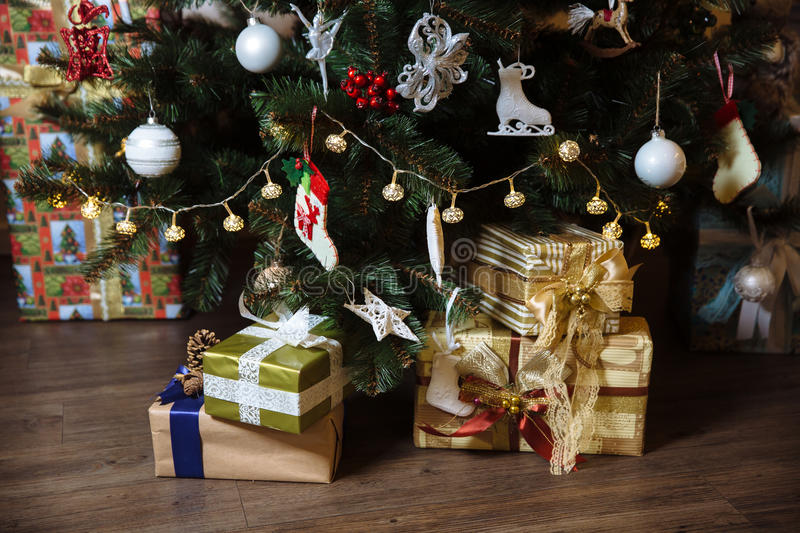 Presents, gift under the Happy New Year and Christmas tree. Concept of family. Presents, gift under the Happy New Year and Christmas tree stock photography
