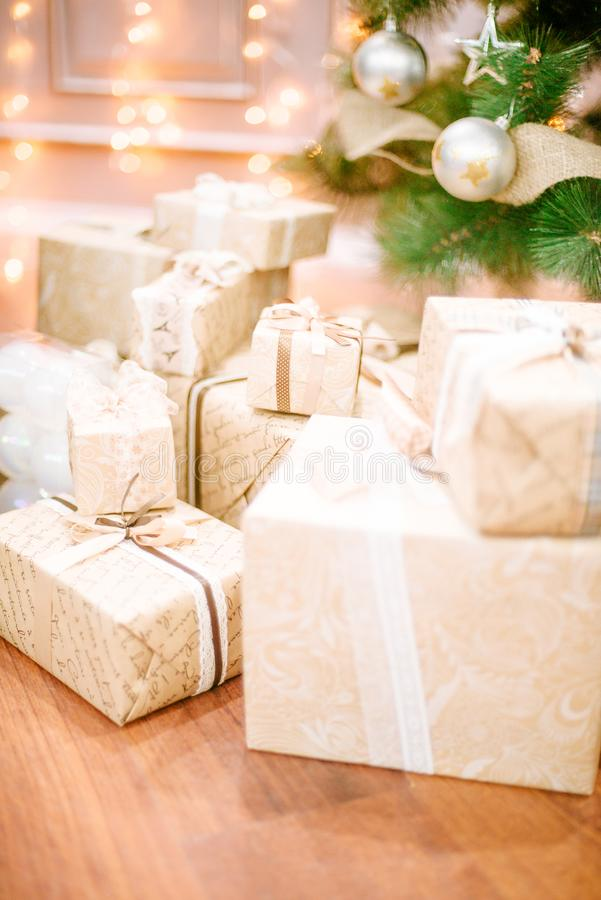 Presents under Christmas Tree in living room stock photos