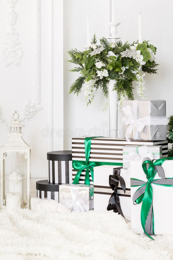 Presents under Christmas Tree in living room. Family Holiday New Year at Home royalty free stock photo