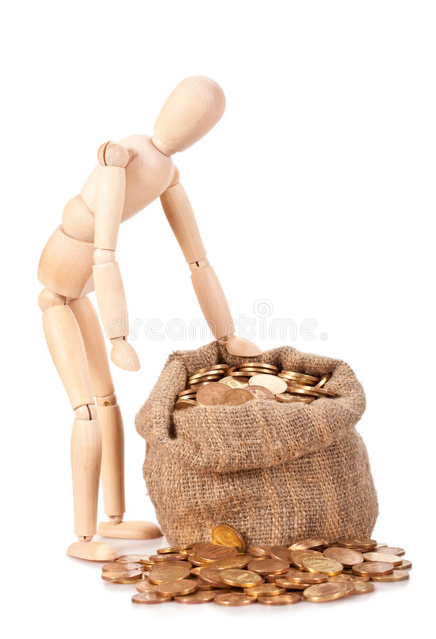 Preservation and augmentation of riches. Person costs near to a bag with money. Preservation and augmentation of riches royalty free stock images