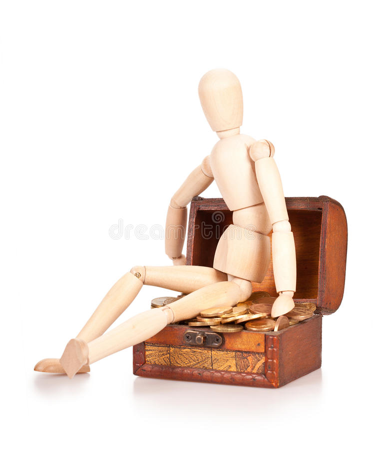 Preservation and augmentation of riches. Person sits on a chest with money. Preservation and augmentation of riches royalty free stock photos