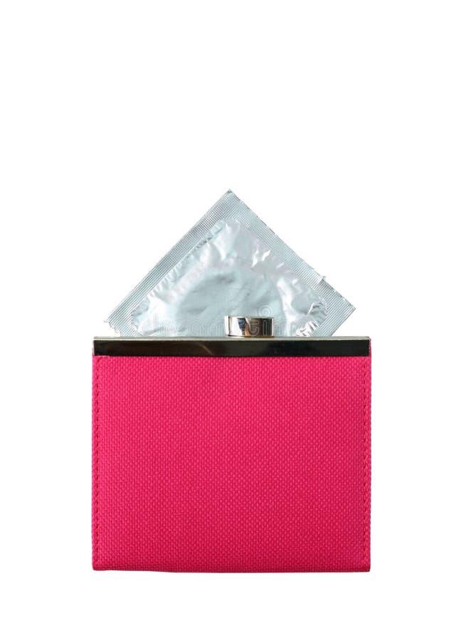 Preservativo en una carpeta rosada foto de archivo libre de regalías