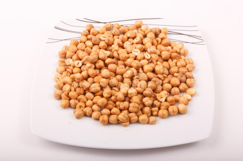 Chickpeas on white dish. Preserved chickpeas on white modern dish, top view royalty free stock images