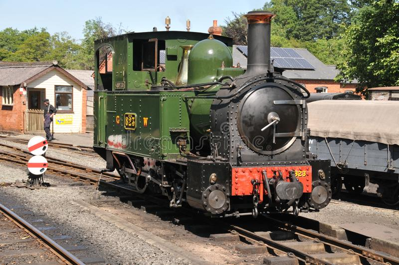 Welshpool & Llanfair Light Railway Steam Engine. Preserved former Great Western Narrow Gauge Railway Steam Engine Number 823 Countess receives attention before royalty free stock photography