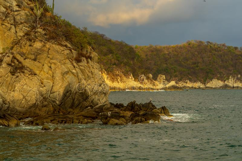 Golden hour on Huatulco Bay, Mexico. Preserved nature, quiet beaches and bays, birds and fauna watching, all for nature lovers at Huatulco, Mexico stock photography