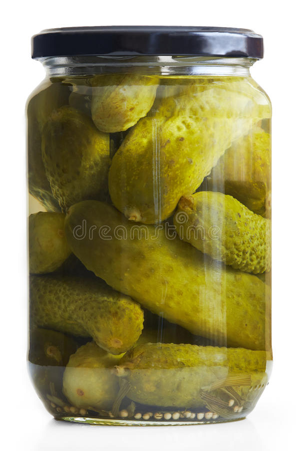 Preserved pickled cucumbers. Jar of pickled cucumbers isolated on white background stock image