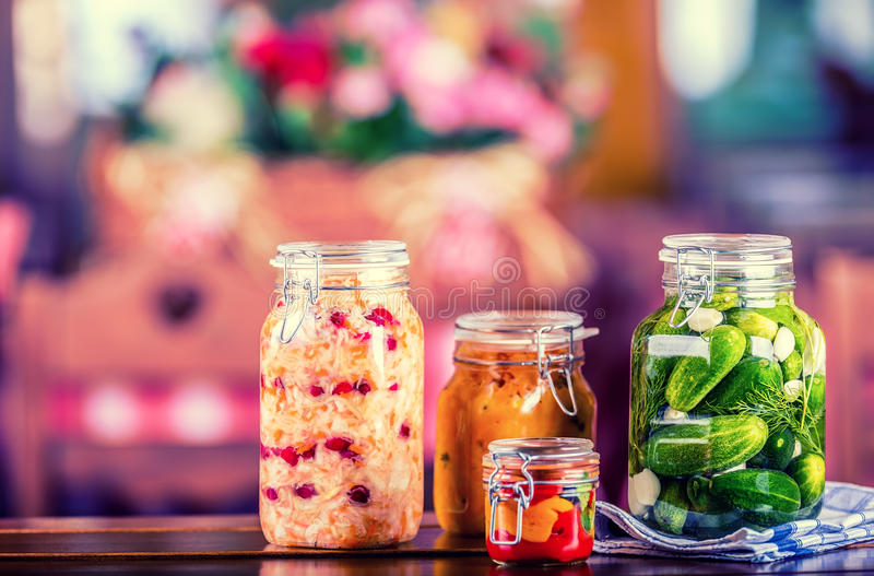 Preserving. Pickles jars. Jars with pickles, pumpkin dip, white cabbage, roasted red yellow pepper. Pickled Vegetables. royalty free stock photos