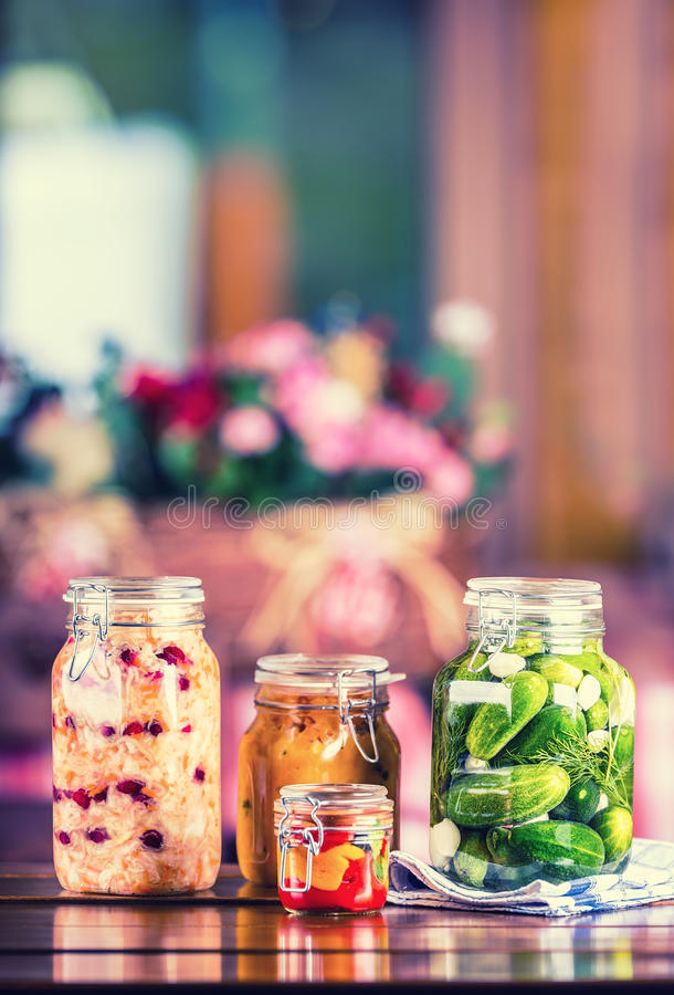Preserving. Pickles jars. Jars with pickles, pumpkin dip, white cabbage, roasted red yellow pepper. Pickled Vegetables. Vegetable royalty free stock photography