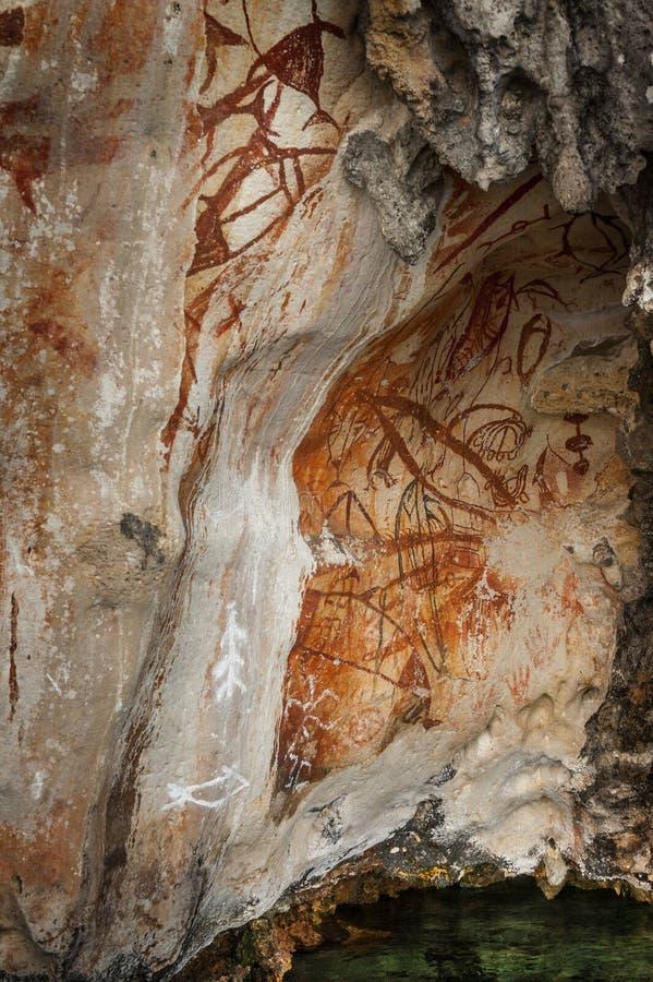 Preshistoric petroglyph rock paintings in Raja Ampat, West Papua, Indonesia. stock photo