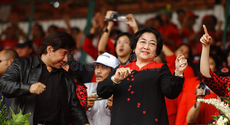 President dancing. Indonesian President to four, Megawati Sukarno Putri dancing with her brother, Guruh Soekarno Putra in the campaign in Surabaya, East Java stock photography