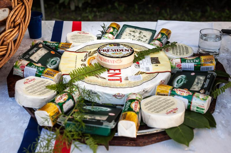 President Camembert surrounded by other French cheese brands of the President group on display. President is a dairy producers royalty free stock photography