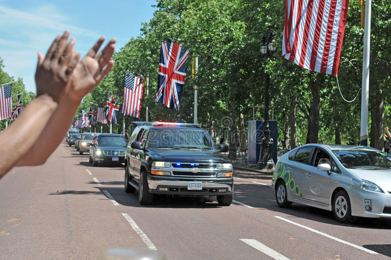 President Obama arrives at Buckingham Palace. US President Barack Obama's motorcade together with a police escort travelled down the Mall on its way to stock photography