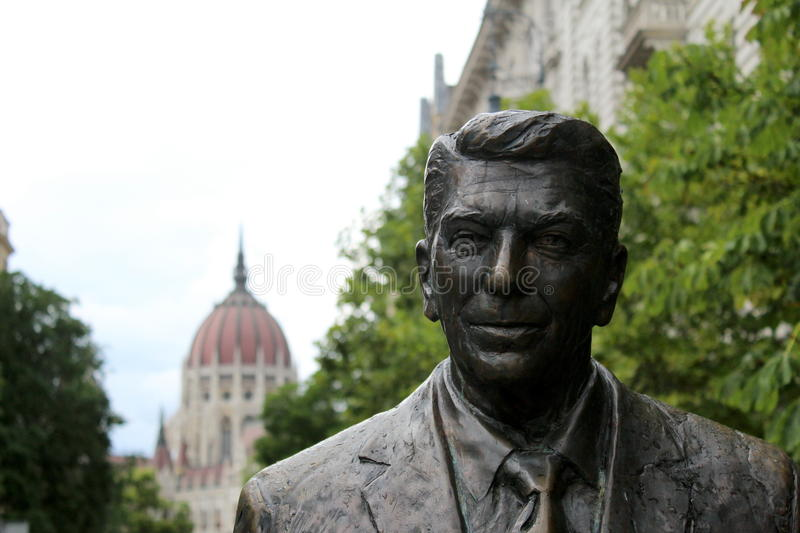 President Reagan. Ronald Reagan statue in Budapest with hungarian parliament on the background stock image