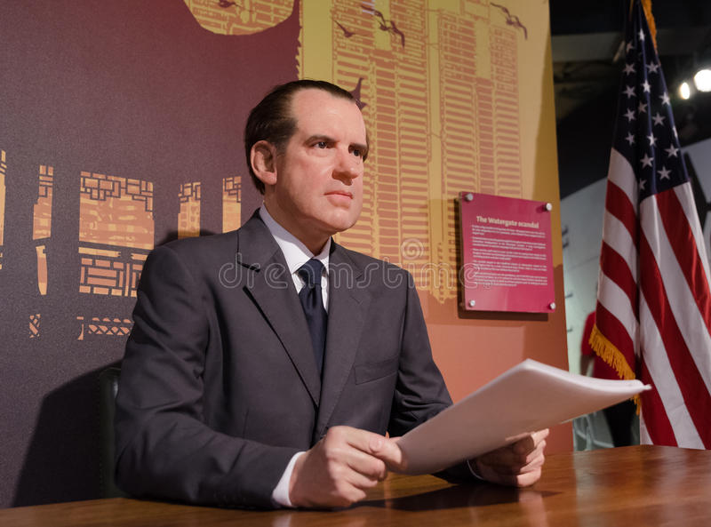President Richard Nixon made of Wax. Wax figure Richard Nixon reading documents with american flag at desk stock photo