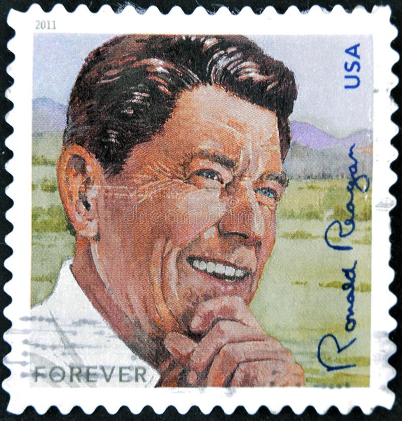 President Ronald Reagan. A stamp printed in USA shows image of President Ronald Reagan stock photos