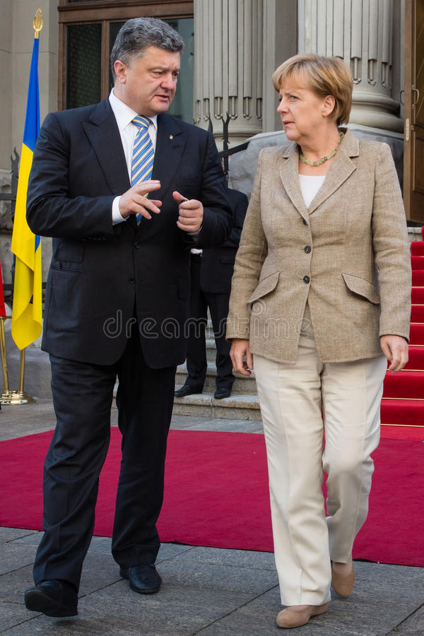 President of Ukraine Petro Poroshenko and Federal Chancellor of. KIEV, UKRAINE - Aug 23, 2014: President of Ukraine Petro Poroshenko and Federal Chancellor of royalty free stock photography