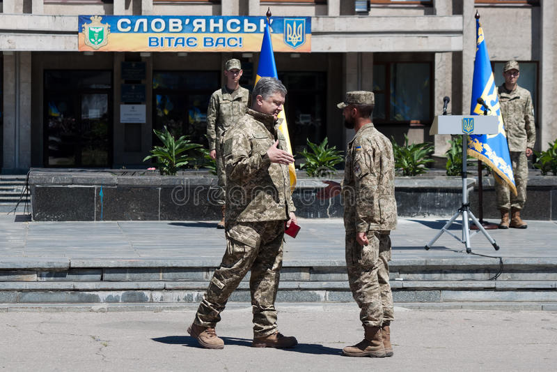President of Ukraine Petro Poroshenko has awarded the soldier stock photo