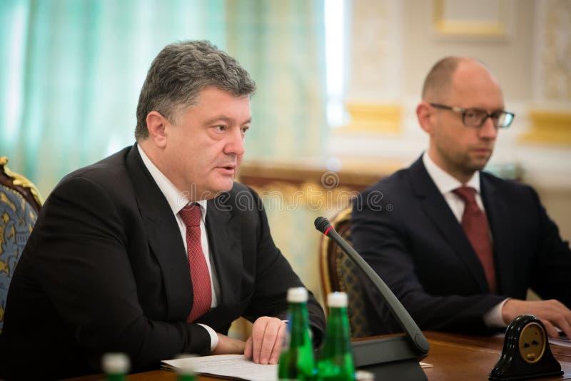 President of Ukraine Petro Poroshenko during the NSDC meeting. KIEV, UKRAINE - Aug 28, 2014: President of Ukraine Petro Poroshenko and Arseniy Yatsenyuk during stock image