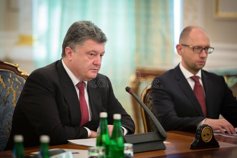 President of Ukraine Petro Poroshenko during the NSDC meeting. KIEV, UKRAINE - Aug 28, 2014: President of Ukraine Petro Poroshenko and Arseniy Yatsenyuk during royalty free stock images