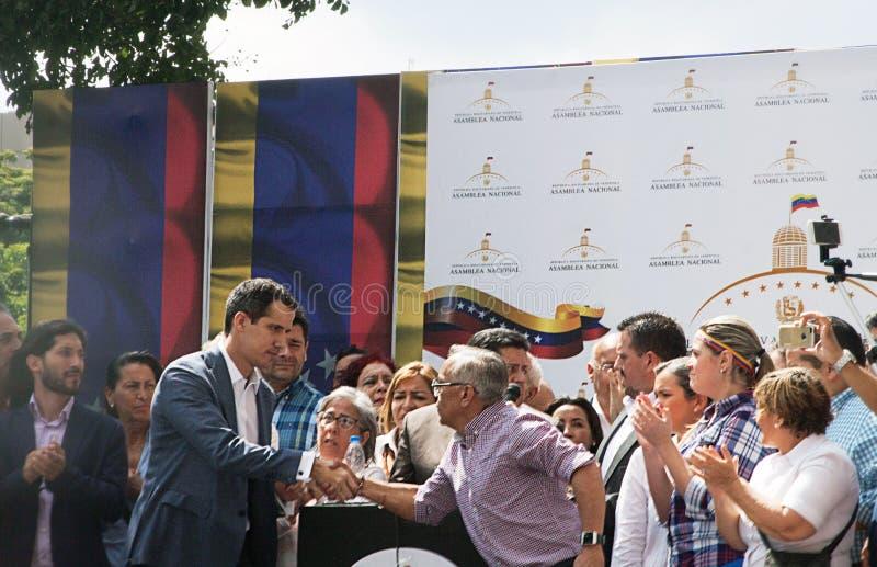 Presidente provvisorio del ³ del Venezuela Juan Guaidà che parla ad una riunione di città a Caracas fotografia stock libera da diritti