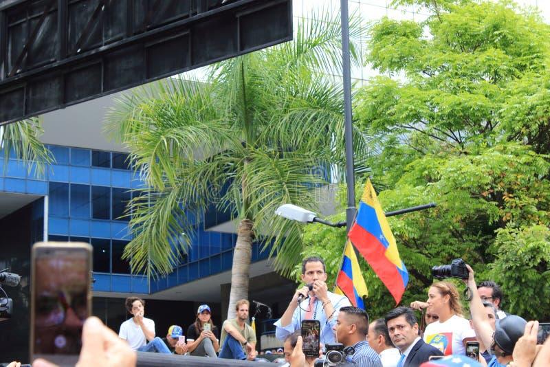 Presidente provvisorio Juan Guaido ha messo in scena le proteste a Caracas mentre il capitale ha lottato senza potere fotografia stock libera da diritti