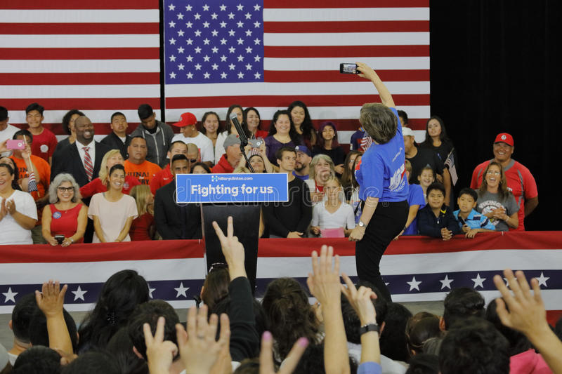 Presidential Candidate Hillary Clinton Campaigns in Oxnard, CA a. OXNARD, CA - JUNE 04, 2016: NY woman takes selfie of crowd for former Secretary of State stock photo